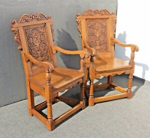 Pair Of Vintage Oak Wood Ornately Carved Spanish Style Arm Chairs