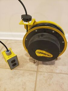 Hubbell Yellow Retractable Cord Reel Dual Outlets 50ft 16 3 Wire