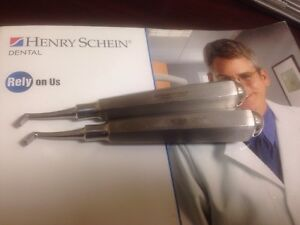 Lot Of 2 Henry Schein Band Pushers