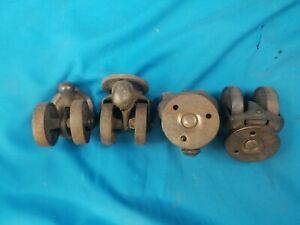 Four Antique Cast Iron Double Wheel Swivel Casters