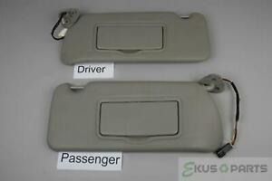 2003 2007 Cadillac Cts Sun Visor Set With Homelink And Lighted Mirrors