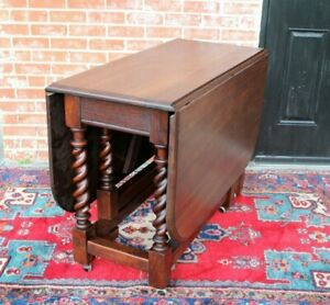 English Antique Oak Barley Twist Drop Leaf Table With Caster Wheels
