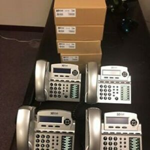 X Blue X16 6 line Small Office Phone System With 8 Titanium X16 Telephones