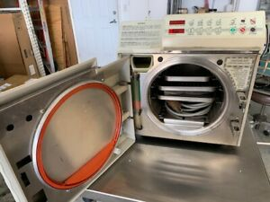 Midmark M 9 Sterilizer With Auto door 2 Large Trays 1 small Tray Power Cord