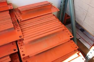 50 Pcs Of Pallet Rack 12 Row Spacers Orange Color In used Condition