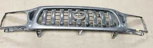 Grille Fits 2001 2004 Toyota Tacoma Dk Gray Plastic used Oe