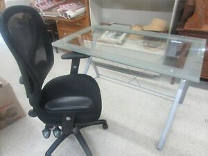 Glass Top Desk With Rolling Office Chair Four Feet By Two Feet