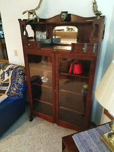 Chippendale Style Cherry Wood 1890s Enclosed Bookshelf Or Curio Cabinet
