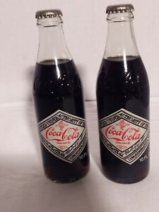1977 Coca Cola 75th Anniversary Commemorative Bottles Set Of 2 10oz Bottles