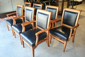 St Timothy Commercial Stacking Arm Chairs set Of 7 Black With Nail Head Trim
