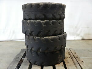 Used 12x16 5 Solid Skid Steer Loader Tire Set