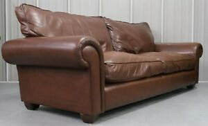 Brown Leather Three Seater Sofa With Feather Filling Cushions On Scroll Arms