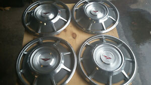 Four 1965 Chevy Corvair Hubcaps