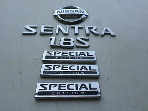 nissan sentra emblem in stock replacement auto auto. Black Bedroom Furniture Sets. Home Design Ideas