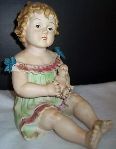 Antique German Bisque Porcelain Piano Baby Girl Holding A Doll Huge