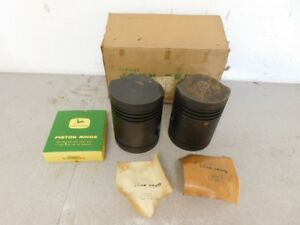 John Deere Mid Styled B Tractor Nos 045 Over Pistons W Rings Ab3993r 10513