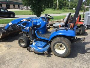 New Holland Tractor Model Tz25da With Loader And 60inch Deck