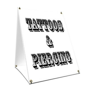 A frame Sidewalk Tattoos Piercing Sign With Graphics On Each Side 24 X 36