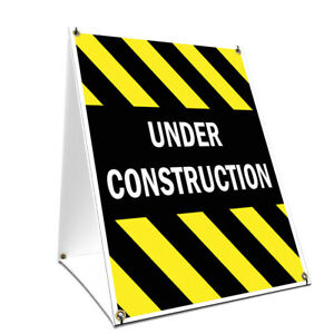 A frame Sidewalk Under Construction Sign With Graphics On Each Side 18 X 24