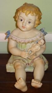 Vintage Germany 11 1 2 Porcelain Piano Baby Girl Holding Doll