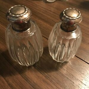 Pair Of Perfume Bottles With Silver Lids Hallmarked