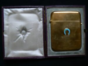 London Gold Coloured Card Holder Case With Horse Shoe On The Front In Case