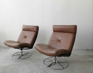 Pair Of Mid Century Leather And Chrome Armless Swivel Danish Style Lounge Chairs