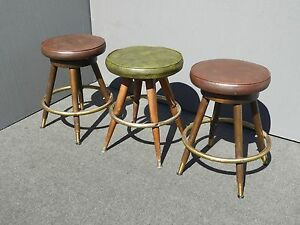 Three Mid Century Brown Green Vinyl Swivel Counter Bar Stools By Calorator