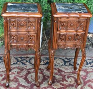 1910s French Antique Pair Of Carved Walnut Black Marble Top Small Nightstands