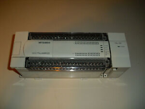 Mitsubishi Melsec Fx2n 64mr ds W Base Unit Fgx2n 2ad Plc And Mounting Bracket