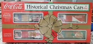 Coca Cola HISTORICAL CHRISTMAS BOX CARS 4 PAC - 0 Gauge Train - New in Box