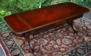 1920s English Regency Mahogany Red Leather Top Drop Leaf Coffee Table Claw