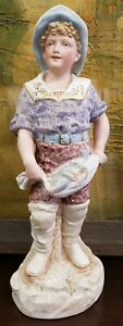 Early 20th Century German Bisque Boy With Fishnet Figurine