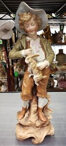 Late 19th Century German Bisque Boy Holding Rabbit Figurine