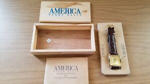 New America Perry Ellis Enjoy Coca-Cola Watch with Date Stainless Steel Back