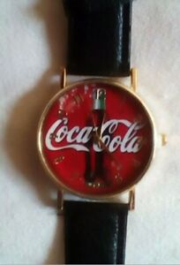BRAND NEW...Coca-Cola Watch  black leather band  gold tone housing
