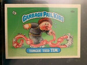 1985 Garbage Pail Kids Stickers #48A TONGUE TIED TIM (GLOSSY).......EX-MT++ $12.09