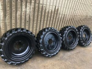 4 Used Solid Skid Steer Tires 10x16 5 Includes Rims