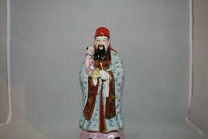 Chinese Famille Rose Enamelled Statue Of Immortal Holding Child