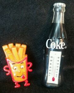 Vintage refrigerator magnet Coca-Cola glass thermometer goofy french fry guy A34