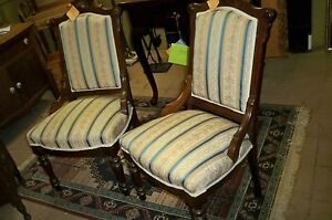 Pair Matching Victorian Walnut Parlor Chairs With Hip Rest Front Brass Castors