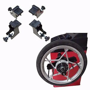 A Set Of Motorcycle Adapters For Sunrise Tire Changer And Wheel Balancer Both