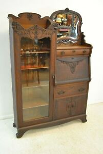 Turn Of The Century Oak Carved Secretary Desk With Beveled Mirror And Bookcase