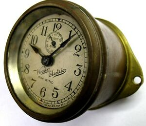 Early Woods Script Electric Car Clock