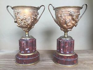 Pair French Bronze Figural Urns Cherubs Satyrs On A Base Of Rouge Marble