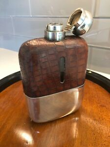Large Crocodile And Silver Hip Flask