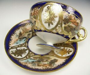 Nippon Hand Painted Scenes Raised Gold Footed Tea Cup Saucer