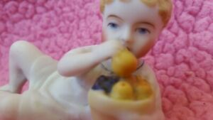Antique German Bisque Piano Baby Figurine Boy With Fruit