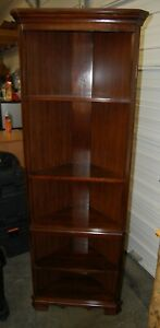 Corner Cabinet Bookcase Wood Cherry Finish 5 Shelves Leveling Legs 2 Available