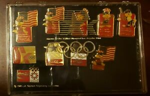 Ten 1984 Olympic Pins of World Flags Coca Cola and Sam Mascot and other make off